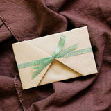Handmade card on brown cloth background. Top view Royalty Free Stock Image