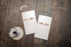 Handmade card with embossed details and pink bow on wood backgro Royalty Free Stock Images