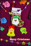 Card. Handmade card `Merry Cristmas`. New Year`s stocking with funny Santa Claus Royalty Free Stock Photography