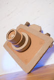 Handmade cardboard camera. On a white background Stock Image