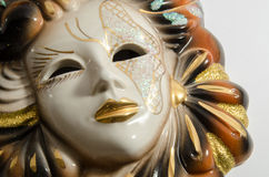 Handmade carnival venetian mask made of porcelain ceramic isolated over white background Royalty Free Stock Images