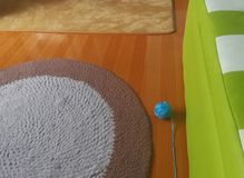 Handmade carpet, knitting ball on the floor in the small room stock photos
