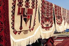 Handmade carpets for muslim prayer. Turkmenistan. Ashkhabad market Royalty Free Stock Image