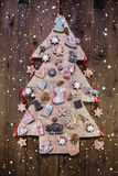 Handmade carved christmas tree decorated with gingerbread, stars Stock Photos