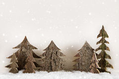 Handmade carved christmas trees on wooden white background. royalty free stock photos