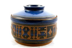 Handmade Carved Pottery. This closeup is a handmade pottery carved with various designs in a dark blue pot and isolated on a light background Stock Photography