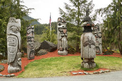 Handmade carved totem poles during cloudy day Royalty Free Stock Images