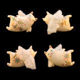 Handmade cats. Four happy handmade angels-cats isolated on black background Royalty Free Stock Image