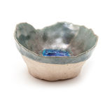 Handmade ceramic pinch pot isolated on a white studio background Stock Photo