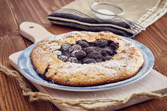 Handmade cherry pie. On a blu dish, on a wooden table. Country style Royalty Free Stock Images