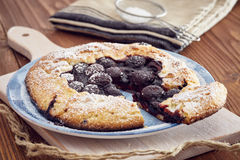 Handmade cherry pie. On a blu dish, on a wooden table. Country style Royalty Free Stock Photos
