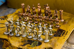 Handmade chess game. Board and pieces for sale in a bazaar Royalty Free Stock Photography