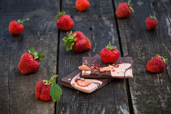 Handmade chocolate bar with dried strawberry slices and fresh be Stock Photos