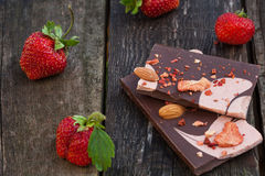 Handmade chocolate bar with dried strawberry slices and fresh be Royalty Free Stock Images