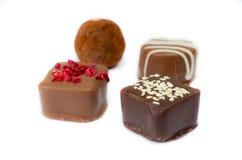Handmade chocolate candies on white background. Handmade chocolate candies isolated on white background Royalty Free Stock Photo