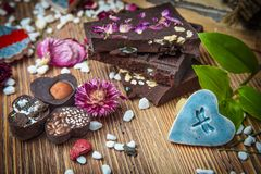 Handmade chocolate, candy and brooch royalty free stock images