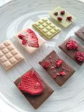 Handmade chocolate: milk chocolate, strawberry chocolate and white chocolate with matcha royalty free stock images