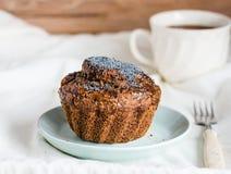 Handmade chocolate muffins with carob, honey, raisins and poppy Stock Images