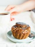 Handmade chocolate muffins with carob, honey, raisins and poppy Stock Image