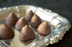 Handmade chocolate truffles on a silver tray Royalty Free Stock Photography