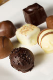 Handmade chocolates. Selection of handmade individual chocolates and truffles Royalty Free Stock Photo
