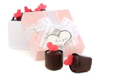Handmade chocolates and pink box with a bow. Stock Image