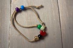 Handmade christian bracelet of twine and beads Royalty Free Stock Image