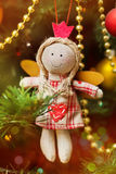 Handmade Christmas angel on fir-tree Royalty Free Stock Photos