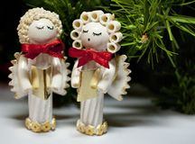 Handmade Christmas angels carolers made from pasta Stock Photo