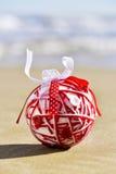 Handmade christmas ball on the beach Stock Image