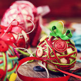 Handmade christmas balls, made with, cords, ribbons and buttons Royalty Free Stock Photos