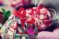 Handmade christmas balls, made with string, ribbon and buttons, Royalty Free Stock Photo
