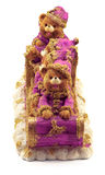 Handmade Christmas bears in sleigh in rose and gold jackets and hats on snow isolated Stock Images