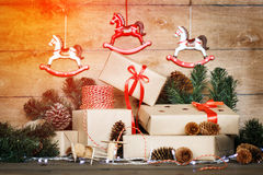 Handmade Christmas composition on wooden background. Stock Photos