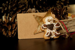 Handmade Christmas cookies, pine cones and cardboard tag Stock Image