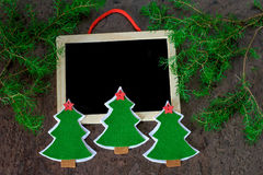 handmade christmas decoration christmas trees from felt with red stars and black chalkboard Royalty Free Stock Photo