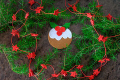 Handmade christmas decoration pudding from felt with red stars Stock Image