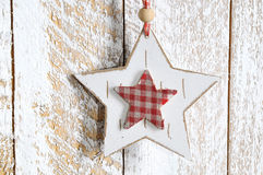 Handmade Christmas decoration. Star hanging on wooden background. Vintage style, old wood background, with space for your text. Winter holidays concept Royalty Free Stock Image