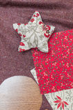Handmade christmas decoration, Star made of fabric. And some other fabrics stock image