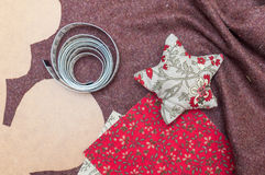 Handmade christmas decoration, Star made of fabric. And some sewing tools and fabrics Stock Photo