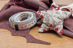 Handmade christmas decoration, Star made of fabric. And some sewing tools and fabrics royalty free stock image