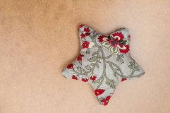 Handmade christmas decoration, Star made of fabric. On wooden background Stock Image