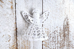 Handmade Christmas decoration. Toy angel on wooden background. Vintage style, old wood background Winter holidays concept Royalty Free Stock Images