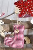 Handmade Christmas decoration. Toy - red christmas sock hanging Royalty Free Stock Images