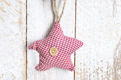 Handmade Christmas decoration. Toy - star hanging Royalty Free Stock Photography