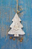 Handmade christmas decoration - tree carved on a blue wooden chr Royalty Free Stock Image