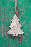 Handmade christmas decoration - tree carved on a green background Royalty Free Stock Image