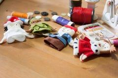 Handmade Christmas doll finger for Christmas gift on wood backgr Royalty Free Stock Photos