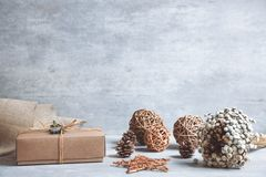 Handmade christmas gift or present box wrapped in kraft paper on stock photography