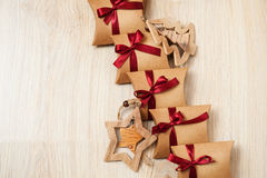 Handmade Christmas gifts from kraft paper and wooden toys on the Christmas tree Royalty Free Stock Photography